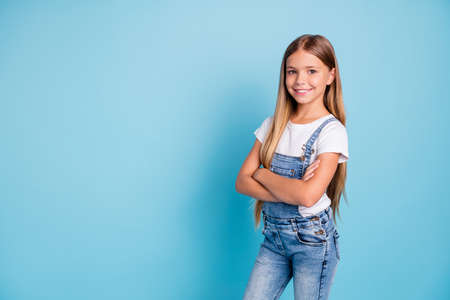 Portrait of her she nice-looking cute lovely attractive cheerful cheery straight-haired blonde girl folded arms copy space isolated on blue pastel background