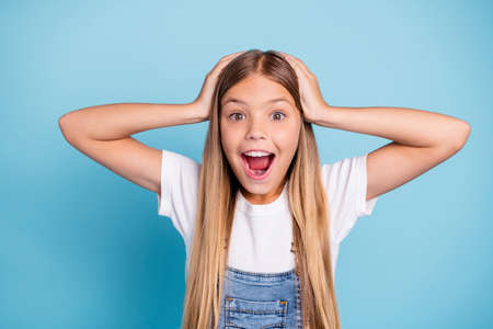 Close-up portrait of her she nice cute lovely sweet attractive funny cheerful cheery straight-haired blonde pre-teen girl opened mouth overjoy isolated on blue pastel background