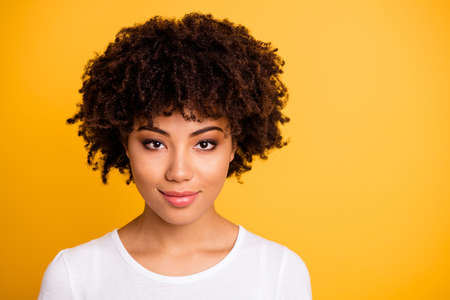 Close up photo beautiful amazing she her dark skin lady lovely look self-confident optimistic nice cool pretty wear casual white t-shirt isolated yellow bright vibrant vivid background Imagens