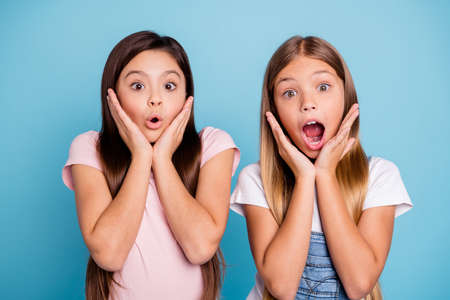 Close-up portrait of two people nice cute attractive charming scared toothy straight-haired pre-teen girls showing omg expression scary news isolated over blue pastel background 写真素材 - 117892710