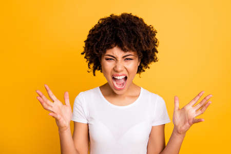 Close-up portrait of her she nice attractive miserable desperate nervous mad frustrated wavy-haired lady screaming loudly isolated on bright vivid shine yellow background