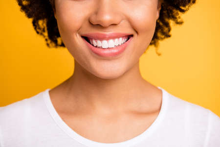 Cropped close up photo beautiful amazing she her dark skin lady sweet beaming whitening toothy smile plump lips wear casual white t-shirt isolated yellow bright vibrant background