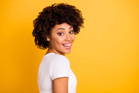 Close up side profile photo beautiful amazing she her dark skin lady lovely look self-confident optimistic nice cool wear casual white t-shirt isolated yellow bright vibrant vivid background