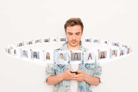 Close up photo interested he him his guy hold smartphone addicted online sit internet pick choose choice illustration pictures girls dating site futuristic creative design isolated white background