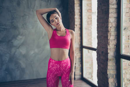 Portrait of nice slender beautiful attractive thin concentrated focused dreamy gorgeous lady doing work-out class dance in modern loft industrial interior style indoors