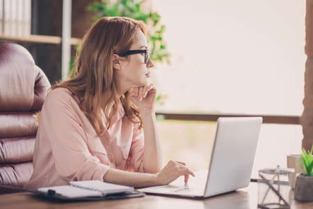 Close up photo beautiful she her business lady best boss having seminar training not interested look inspired window boredom notebook table sit big office chair wearing specs formal-wear shirt.