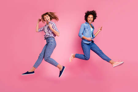 Full length body size view of two person nice crazy cool attractive charming cheerful funny funky playful girls having fun time weekend isolated over pink pastel background