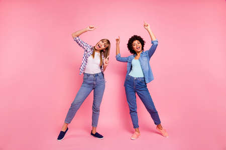Full length body size view photo two funky diversity she her ladies dancing pop modern rhythms attend hip-hop classes wear casual jeans denim checkered shirt clothes outfit isolated pink background Banque d'images