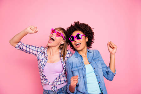 Portrait of two person nice lovely fascinating fashionable attractive charming carefree cheerful girls wearing casual checkered shirt having fun isolated over pink pastel background Stock Photo