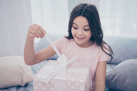 Close up photo sweet emotionally beautiful she her little girl sitting bed hold opening present box best day ever wear home t-shirt pants comfortable apartments flat bright light colored room indoors Stock Photo