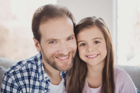 Close-up portrait of his he her she nice charming attractive cheerful cheery pre-teen girl dad daddy in light white interior room indoors Stock Photo - 119386060