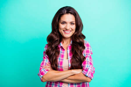 Portrait of her she nice-looking attractive lovely sweet funny cheerful wavy-haired lady wearing checked shirt isolated over teal turquoise bright vivid shine background