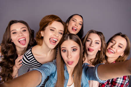 Close up top above high angle view photo beautiful she her six ladies roommates make take selfies fooling around wearing casual jeans denim checkered striped clothes outfit isolated grey background