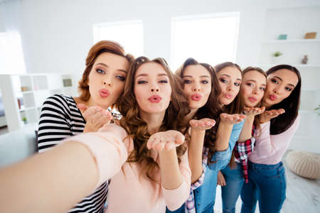 Close up photo beautiful she her ladies big family roommates make take selfies send kiss group mates photo set together before graduation excited amazed bright white room girls day night indoors