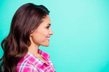 Close up side profile photo amazing white teeth beautiful she her lady look watch see empty space attentively wearing casual plaid checkered pink shirt outfit isolated teal bright vivid background Imagens - 119389156