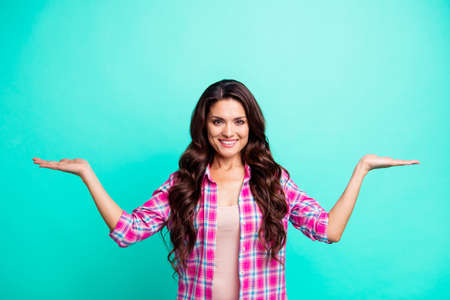 Close up photo beautiful amazing she her lady hands palms arms open empty space advising new product pick better wearing casual plaid checkered pink shirt outfit isolated teal bright vivid background Imagens