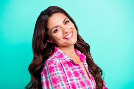 Close up side profile photo amazing white teeth toothy beautiful she her lady overjoyed sincerely feminine wearing casual plaid checkered pink shirt outfit isolated teal bright vivid background
