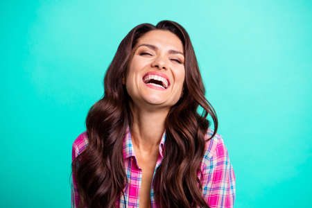 Close up photo amazing she her lady laughing out loud scream shout yell eyes closed overjoyed toothy open mouth wearing casual plaid checkered pink shirt outfit isolated teal bright vivid background Banco de Imagens