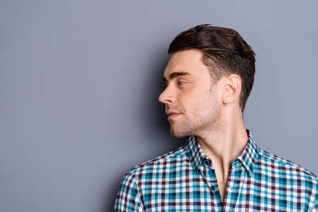 Close up side profile photo attractive amazing he him his man turn head look empty space perfect styling hair light stubble wearing casual plaid checkered outfit isolated grey background