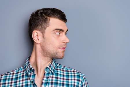 Close up side profile photo attractive amazing he him his man boyfriend turn head look empty space perfect styling hair light stubble wearing casual plaid checkered outfit isolated grey background