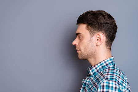 Close up side profile photo attractive amazing he him his man ideal perfect hairdo styling look interest empty space wearing casual plaid checkered shirt jeans denim outfit isolated grey background Reklamní fotografie
