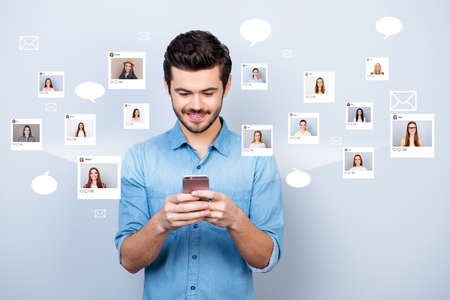 Close up photo interested he him his guy hold smartphone addicted online sit internet pick community age illustration pictures girls dating site futuristic creative design isolated white background 免版税图像