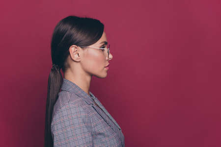 Profile side portrait of her she nice cute classy attractive lovely charming well-groomed candid calm lady isolated over maroon burgundy marsala pastel background