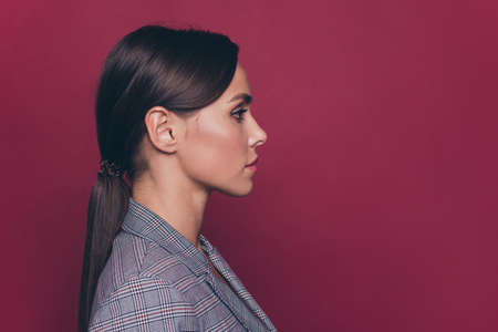 Close-up profile side portrait of her she nice cute attractive lovely adorable charming well-groomed candid calm lady professor isolated over maroon burgundy marsala pastel background Stock fotó