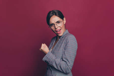 Portrait of her she nice cute attractive lovely winsome cheerful classy smart clever lady wearing gray checkered blazer great good news attainment isolated over maroon burgundy marsala background Banque d'images