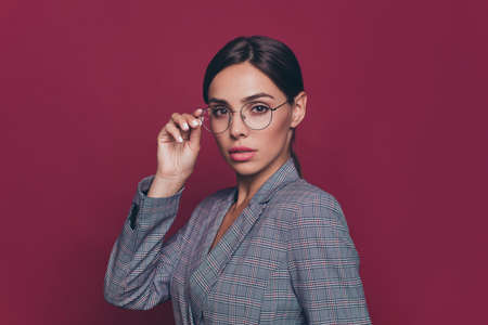 Close up side profile photo beautiful amazing business she her lady hold one hand arm specs look wondered hmm just started career wearing formal-wear isolated dark red vivid background
