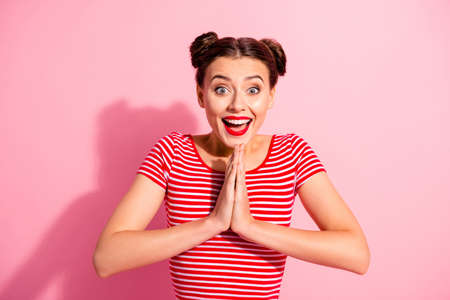 Close up photo funky beautiful she her lady pretty hairdo two buns hold hands arms together I need buy buyer these all daddy mommy wear casual striped red white t-shirt isolated pink background