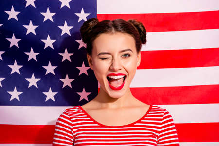 Close-up portrait of her she nice cute charming attractive lovely winsome girlish glamorous cheerful cheery excited girl wearing striped t-shirt isolated over american flag background