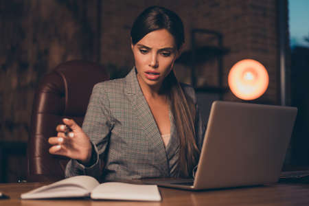 Close up photo beautiful she her business lady look notice wrong numbers report I would kill you look letters notebook notification table sit big office chair wear formal-wear checkered plaid suit Standard-Bild