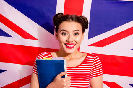 Close-up portrait of her she nice cute charming glamorous lovely winsome sweet attractive cheerful girl wearing striped t-shirt bachelor isolated over british flag background Banque d'images