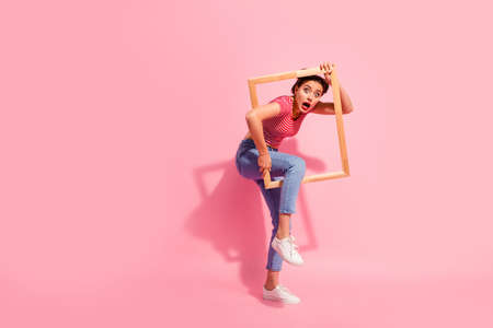 Full length body size view of her she nice cute charming attractive glamorous worried girl in casual striped t-shirt jeans trying to escape break rules borders life isolated over pink background Stock fotó