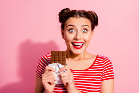 Close-up portrait of nice cute charming attractive glamorous crazy cheerful cheery girl in striped t-shirt holding in hands desirable dessert life lifestyle advert isolated on pink pastel background