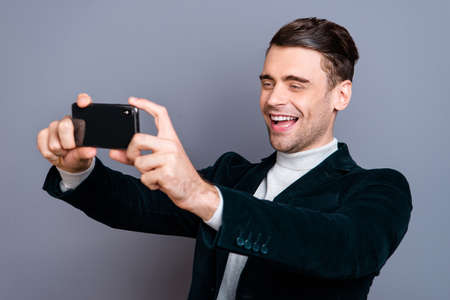 Portrait of his he nice attractive handsome bearded cheerful cheery positive guy wearing velveteen blazer making taking selfie day isolated over gray blue pastel background