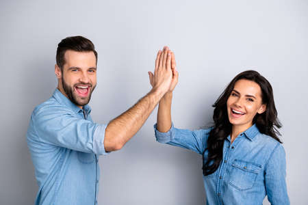 Close up side profile photo amazing she her he him his couple lady guy clapping hands arms teamwork bonding good job work wear casual jeans denim shirts outfit clothes isolated grey background