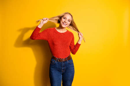 Portrait of her she nice-looking cute attractive winsome lovable fascinating lovely adorable cheerful cheery girl making ponytails isolated over bright vivid shine orange background Stock Photo