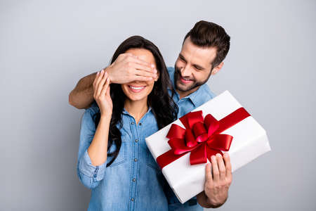 Close up photo amazing she her he him his lady guy hide eyes guess who game prepared romance surprise hold big large giftbox wear casual jeans denim shirts outfit clothes isolated grey background Banco de Imagens - 119454439