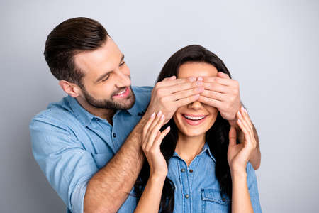 Close up photo amazing she her he him his couple lady guy hide eyes guess who game prepared romance surprise night evening wear casual jeans denim shirts outfit clothes isolated grey background Banco de Imagens