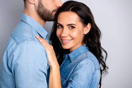 My love life. Cropped close up portrait of married inspired affectionate people relaxed enjoying company receiving warm embraces wearing casual denim outfit isolated over ashy-gray background Stock Photo