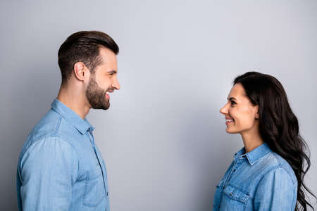 Lets talk. Profile side photo of cute positive beautiful students fellows staring speaking telling greeting having dialogue dressed in denim clothing isolated on argent background