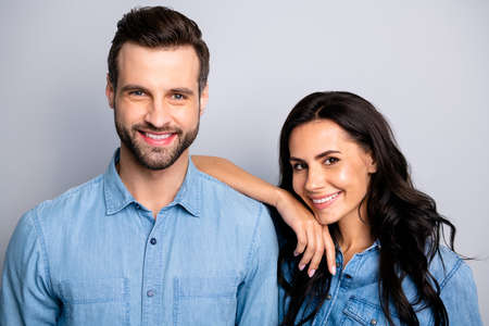 Close up photo of young new perfect bonding family showing tenderness gentleness isolated touching shoulder by arms wearing denim jackets on silver background Stock Photo
