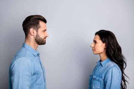 Profile side view photo of confident inspired isolated person people having talk speaking dialogue thoughts isolated on silver background wearing denim casual beautiful outfit