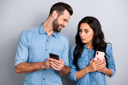 Close up photo wondered astonished she her he him his lady guy telephone smart phone hands arms reader news crazy eyes wear casual jeans denim shirts outfit clothes isolated light grey background