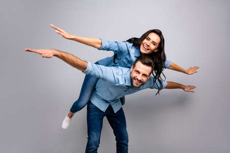 Close up photo cheer funky she her he him his lady guy amazed hands arms like wings piggy-back ride walk highway adventures wear casual jeans denim shirts outfit clothes isolated light grey background