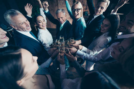 Close up top above high angle photo business people different age race she her he him his excited amazed company hands arms raised up golden wine friendship friends formal wear jackets shirts