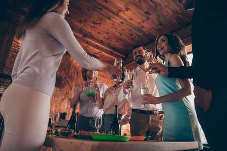 Low below angle view company of nice charming attractive pretty elegant cheerful positive ladies gentlemen having fun annual event tradition birthday celebratory in wood industrial loft interior room