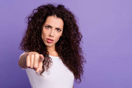 Close up photo beautiful her she lady hand arm index finger point you restriction stop stand there dont move warn attention wear casual white t-shirt clothes outfit isolated violet purple background